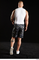 Grigory  1 back view camo shorts dressed sports walking white sneakers white tank top whole body 0002.jpg